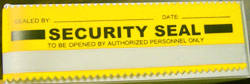 yellow security tape seal